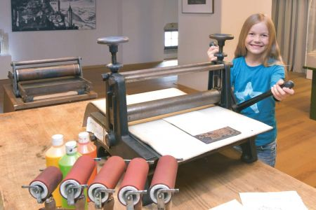 Girl at the printing press